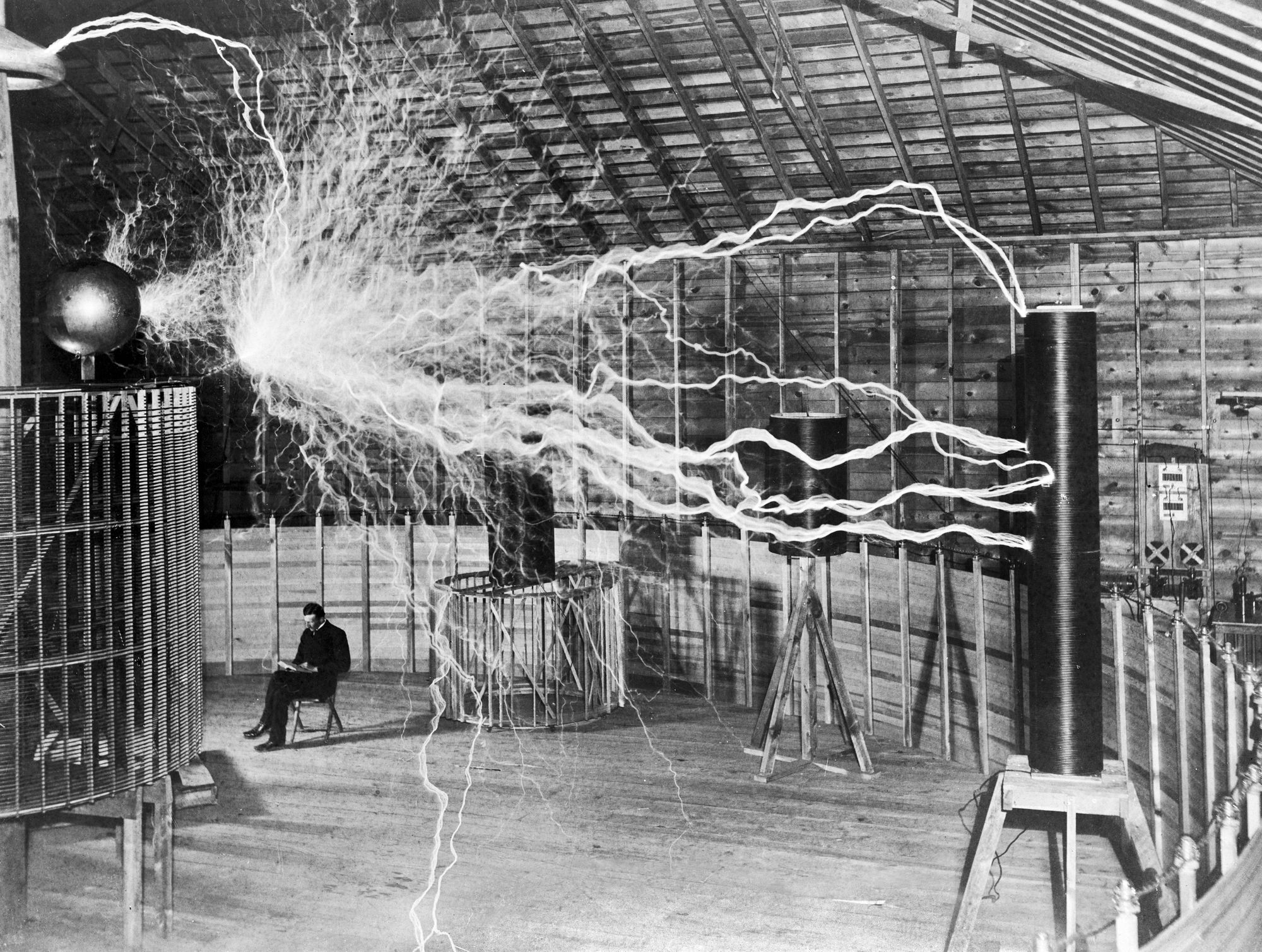 Nikola_Tesla-_with_his_equipment_EDIT-1